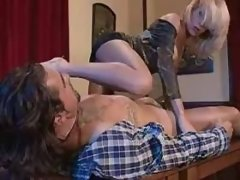 Tattooed hunk sucked by TS on table
