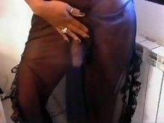 Glamour ebony shemale masturbates