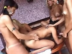 Four shemales fucking coed on table
